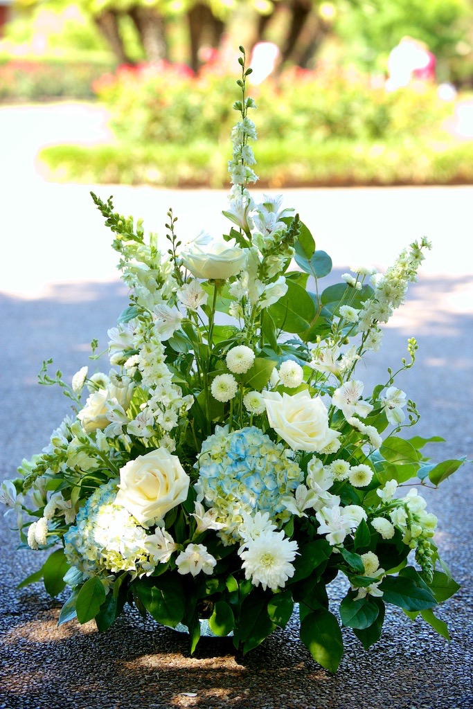 Outdoor Ceremony Florals Blue Hydrangeas Cream Roses Jackson Square New Orleans Wedding www.eauclairephotographics.com