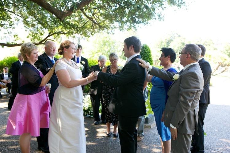 Outdoor Ceremony Bride Groom Hand Ceremony Jackson Square New Orleans Wedding www.eauclairephotographics.com