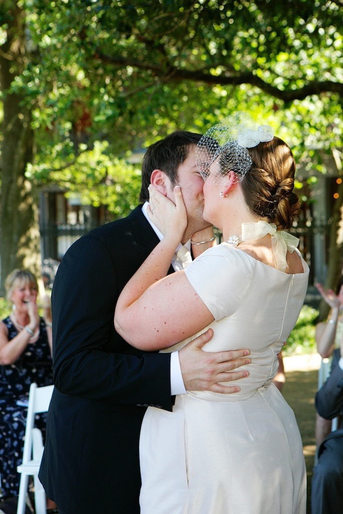 Outdoor Ceremony Jackson Square Bride Groom First Kiss www.eauclairephotographics.com