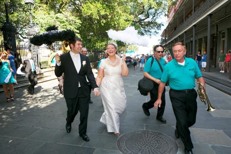 Second Line Parade Bride Groom Umbrellas New Orleans Wedding www.eauclairephotographics.com