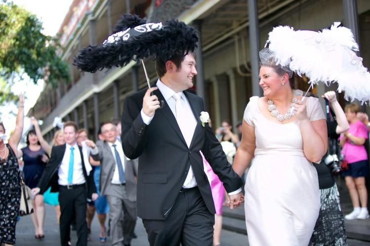 Second Line Parade Jackson Square Bride Groom Umbrellas Guests Hankies New Orleans Wedding www.eauclairephotographics.com
