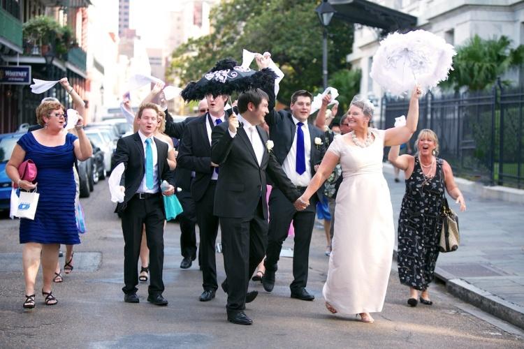 Second Line Parade French Quarter Bride Groom Umbrellas Guests Hankies New Orleans Wedding www.eauclairephotographics.com